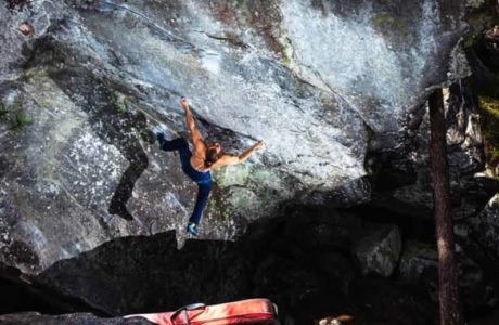 Jonas Winter climbs the 8c boulder Power of Now in Magic Wood