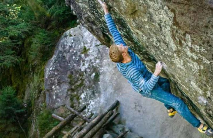 The Austrian Jakob Schubert manages the first ascent of the 8c boulder La Force Tranquille in the Swiss bouldering area Magic Wood.