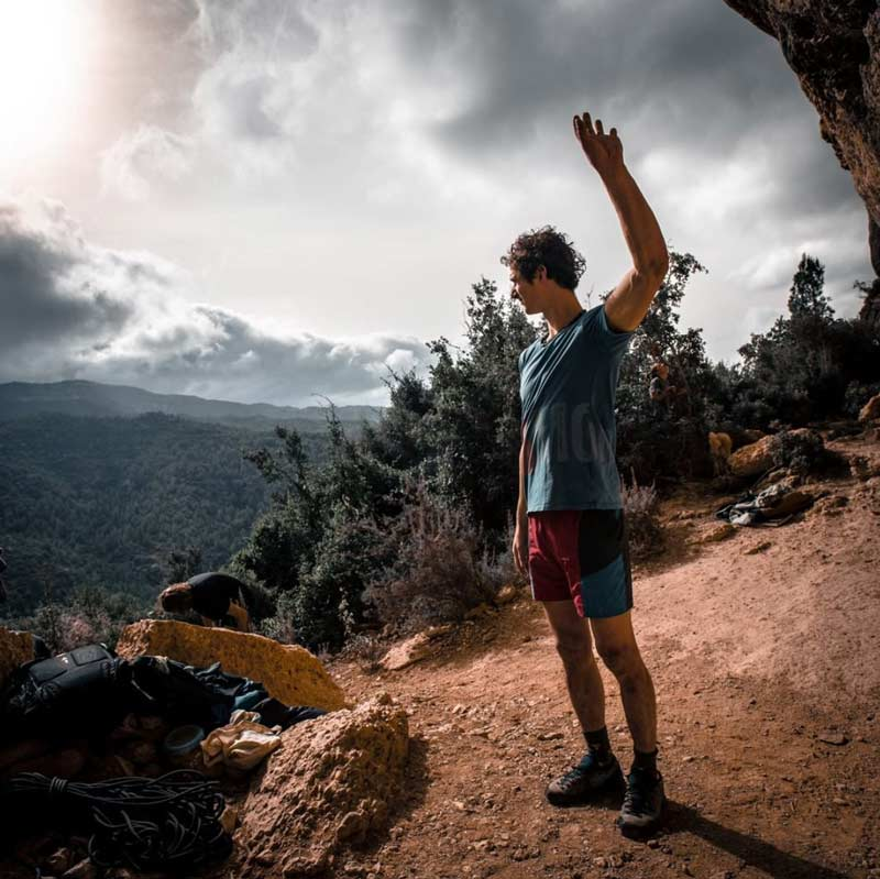Adam Ondra checks which direction the wind is coming from. (Photo by Petr Chodura)